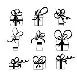 Nine white gift boxes. Black bows and ribbons. Stock Photography