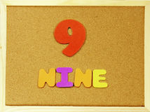 Nine word on a corkboard Stock Images