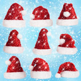 Nine Xmas hats with lights and snow Stock Photos