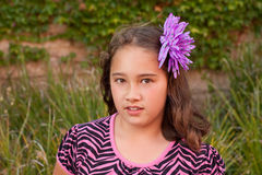 Nine year old girl with flower in hair Stock Photos