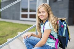 Nine years old girl student at school. A nine years old girl student at school Royalty Free Stock Image