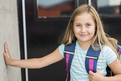 Nine years old girl student at school. A nine years old girl student at school Royalty Free Stock Photos