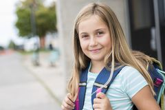Nine years old girl student at school. A nine years old girl student at school Stock Photo