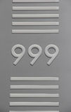 999  3 nines Number Signage with Horizontal Bars. 999 Signage symbolism 3 nines with Horizontal Bar frame emergency urgent telephone number Royalty Free Stock Photography