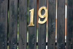Nineteen Number Address House on Gate Stock Image
