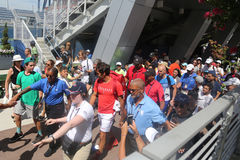 Nineteen times Grand Slam Champion Roger Federer of Switzerland walking toward Grandstand stadium surrounded by tennis fans stock image