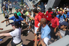 Nineteen times Grand Slam Champion Roger Federer of Switzerland walking toward Grandstand stadium surrounded by tennis fans stock photos