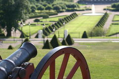 Nineteenth century cannon overlooking botanical garden. This cannon stands atop a hill between the Uppsala Castle and the Uppsala Botanical Garden. In the Stock Images