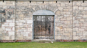 Nineteenth century ruins with barred entrance Stock Photos