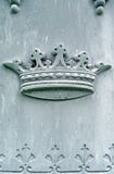 Nineteenth century tombstone detail crown. Background image of details of a nineteenth century tombstone with crown bas-relief Royalty Free Stock Photography