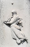Nineteenth century tombstone detail woman and star. Image of the details of a weathered nineteenth century gravestone with bas-relief female figure and star Royalty Free Stock Photos