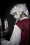 Nineteenth, gentleman rococo era wig, chandelier with candles. Gentleman rococo era wig, man dressed in vintage Royalty Free Stock Photography
