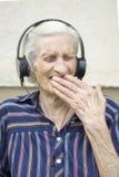 Ninety years old woman reaction to modern music. Grandma listeni Stock Photography