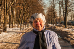 Ninety years old woman walking. Photo took in Moscow, Russian Royalty Free Stock Image