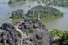 Ninh Binh, Vietnam. mountain temple and flooded fields stock images