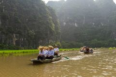 Boats of tourists on the Ngo River at Trang An UNESCO World Stock Images