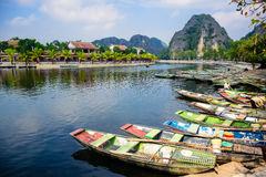 NINH BINH, VIETNAM: Lots of boats waiting for tourists for cave tours in Ngo Dong River at Tam Coc, Ninh Binh P Stock Image