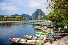 NINH BINH, VIETNAM: Lots of boats waiting for tourists for cave tours in Ngo Dong River at Tam Coc, Ninh Binh P Stock Photo