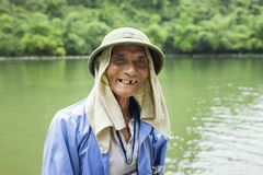 Ninh Binh, Vietnam - May 16, 2015: Close-up portrait of old tourist rowing boat man at Tam Coc travel destination, Ninh Binh Stock Photos