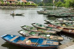 Ninh Binh, Vietnam - May 16, 2015: Tourism boats stay next to each others waiting for tourist at Tam Coc, the popular travel desti stock image