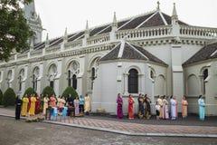 Ninh Binh, Vietnam - May 16, 2015: Vietnamese Christian women wearing traditional dress Ao Dai perform ritual at local church stock photography