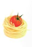 Ninho e tomate da massa Imagens de Stock Royalty Free