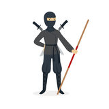 Ninja assassin character in a full black costume standing with katana swords behind his back and bamboo training sword Stock Photography