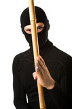 Ninja in black mask. Close up portrait of male ninja in black mask covered his face on white background Royalty Free Stock Photo