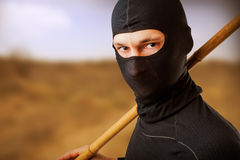 Ninja in black mask. Close up portrait of male ninja in black mask covered his face Stock Photos