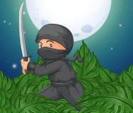 Ninja holding sword in the bush Stock Photo