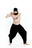 Ninja man holds knife and is ready to attack on white background Stock Photos