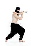 Ninja manhåll baktalar och är klara att anfalla på vit bakgrund Arkivfoton