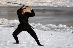 Ninja med svärdet på vintern Fotografering för Bildbyråer