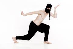 Ninja na białym tle Męski wojownik w czerni ubraniach Obrazy Stock