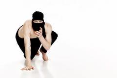 Ninja na białym tle Męski wojownik w czerni ubraniach Zdjęcie Stock