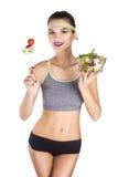 Ninja Portrait av kvinnan som äter grönsaker, bantar Arkivfoto