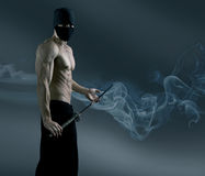 Ninja retira a espada do katana Imagens de Stock Royalty Free