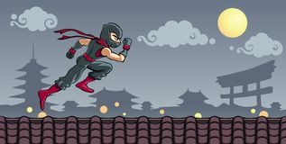 Ninja on the Roof. A ninja warrior running above the roof on the middle of the night Stock Photo