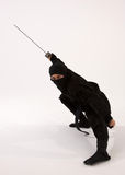 Ninja with Sword. In martial art pose against high key background Stock Images