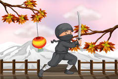 A ninja with a sword Royalty Free Stock Photos