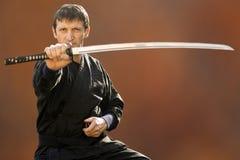 Ninja with sword Stock Photo