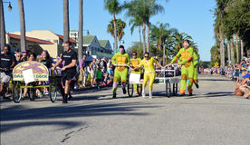 Ninja turtle costumes in a bed race. VENICE, FL - OCTOBER 18:  Competitors pushing a bed in competition during the 11th Annual Venice Sun Fiesta bed race on Royalty Free Stock Images