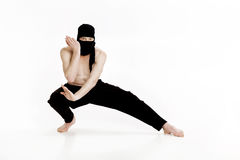 Ninja on white background. Male fighter in black clothes Stock Photos