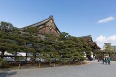 Ninomaru palace of Nijo Castle in Kyoto, Japan. Visitors walk past the Ninomaru palace of Nijo Castle in Kyoto, Japan. Nijo Castle was built in 1603 as the Kyoto Stock Image