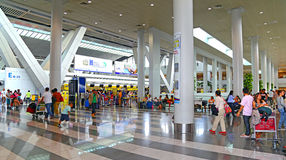 Ninoy aquino international airport, philippines. Busy travelers at the check-counters at ninoy aquino international airport, philippines Stock Image