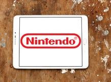 Nintendo logo. Logo of game developer company nintendo on samsung tablet on wooden background stock photography