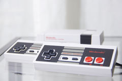 Nintendo NES Classic Edition with Reflection. 1 pair of controllers show at front Stock Images