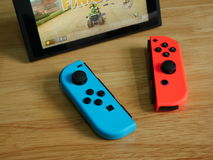 Nintendo Switch, the video game console on wooden table. Royalty Free Stock Photos