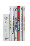 Nintendo Wii games and Controller. A studio shot of a stack of 6 Nintendo Wii video games and controller. Games include Donkey Kong Country Returns, The Legend Stock Photo