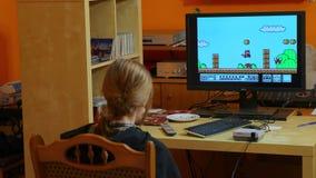 Nintengo NES, jugando a Mario estupendo 3 almacen de video